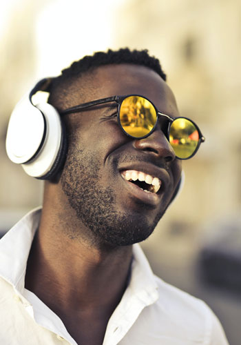 Man with headphones and a smile